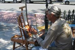 Man painting at a plein air festival