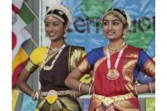 Two women in traditional costumes at the International Festival