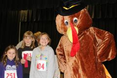 Kids with a turkey mascot