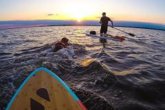 Glide along the water with a stand-up paddleboarding session at sunset.