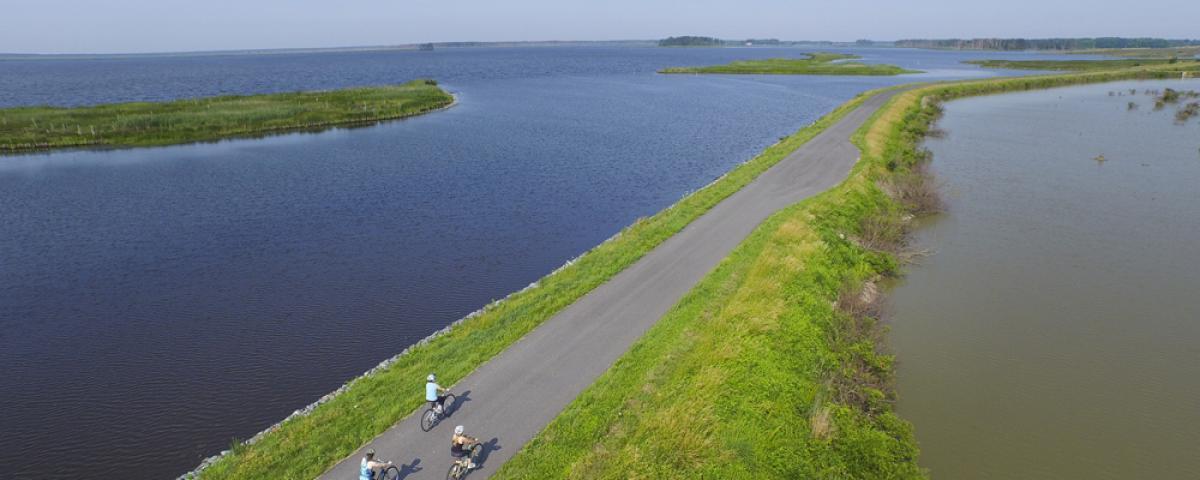 three bikers in waterfront trail