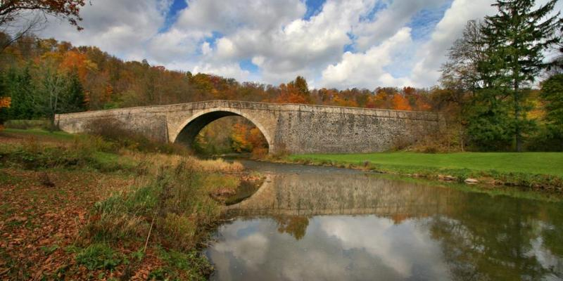 This historic stone-arched Casselman River Bridge in Grantsville once carried horse-drawn carriages and wagons headed westward on the Historic National Road.