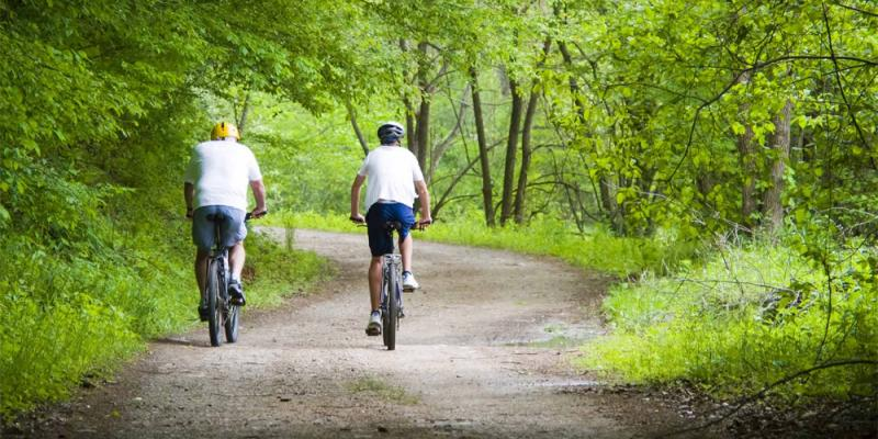 two men on bike trail