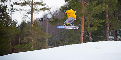 A Snowboader in a jump on a hill at WiSP