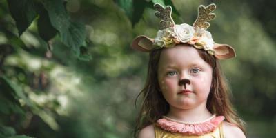 girl wearing woodland creature crown headband