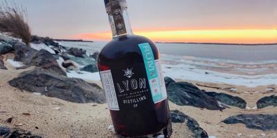 Bottle of Lyon Rum on a beach
